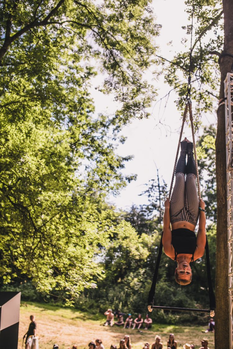 female acrobat hanging from a tree during Noisily Festival 2018