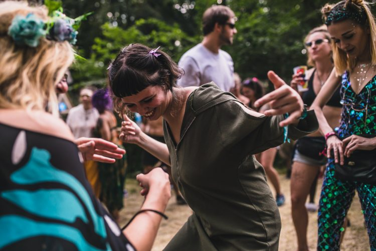 woman in dark green top dancing at Noisily Festival 2018