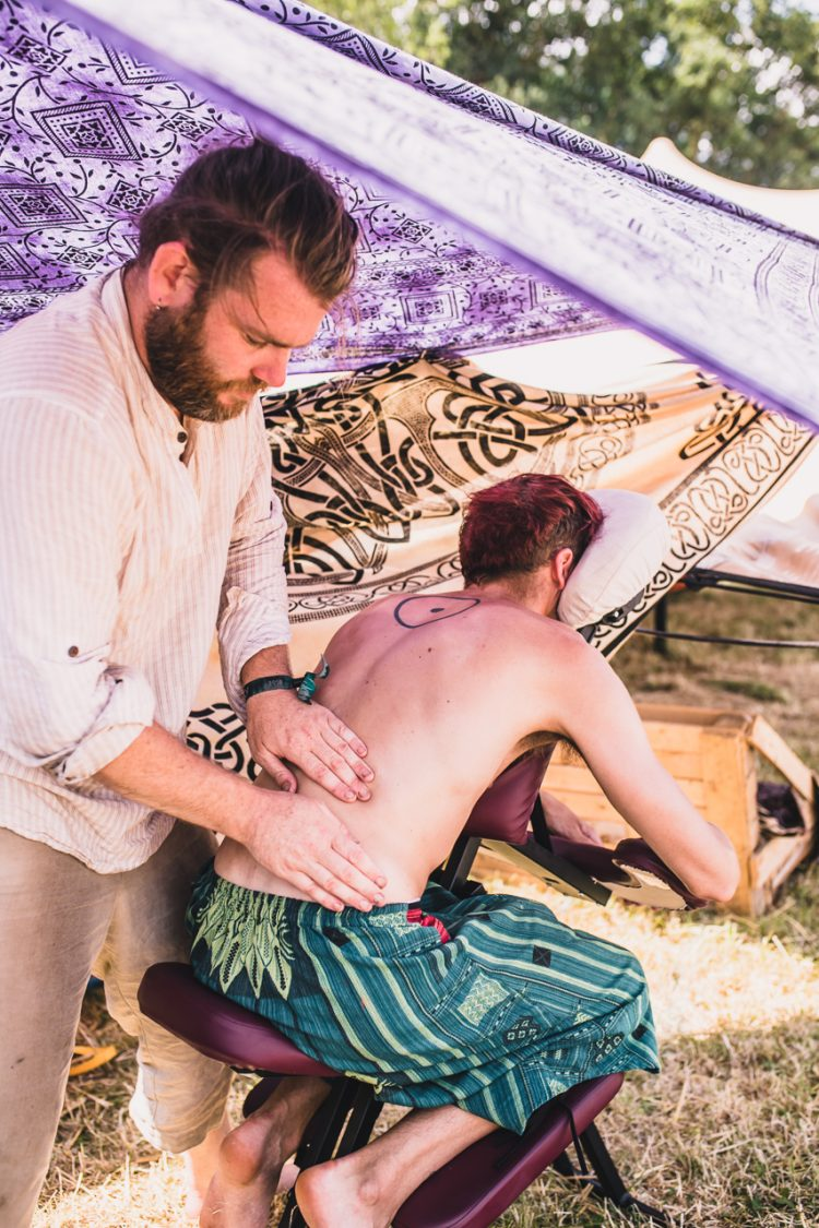 masseuse massaging a man's back at Noisily Festival 2018