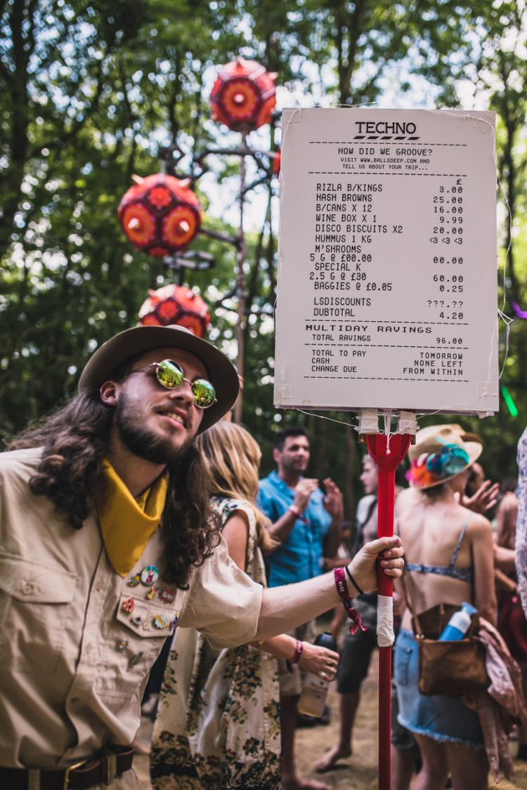 man in fancy dress with funny Tesco sign during Noisily Festival 2018