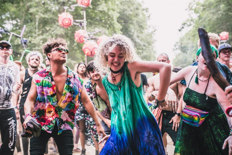 woman in green dress dancing during Noisily Festival 2018