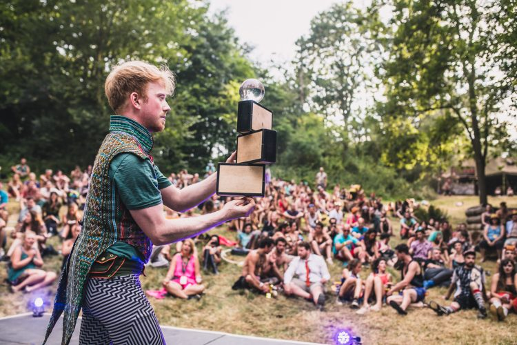 male performer performing magic tricks on a Noisily Festival 2018 stage