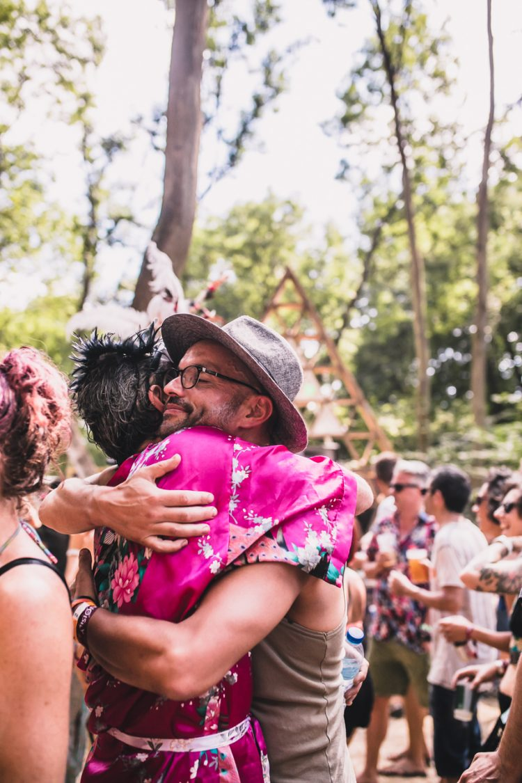 man in hat embraces woman during Noisily Festival 2018