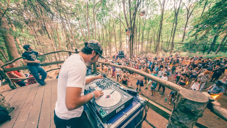 man djing with vinyl on wooden stage at Noisily Festival 2018
