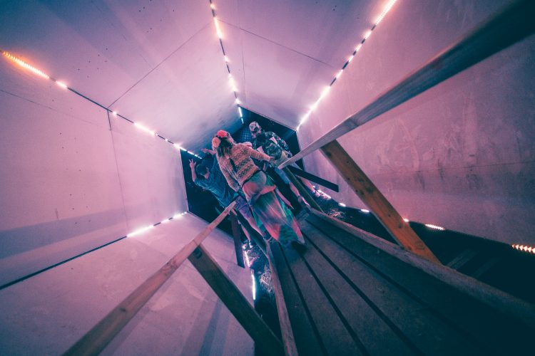 young woman walking through light tunnel at Noisily Festival 2018