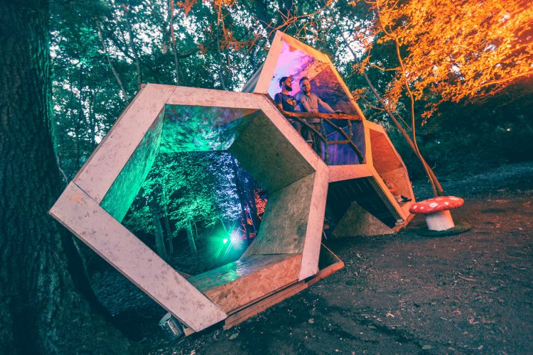 two male DJ's performing inside a wooden art installation during Noisily Festival 2018