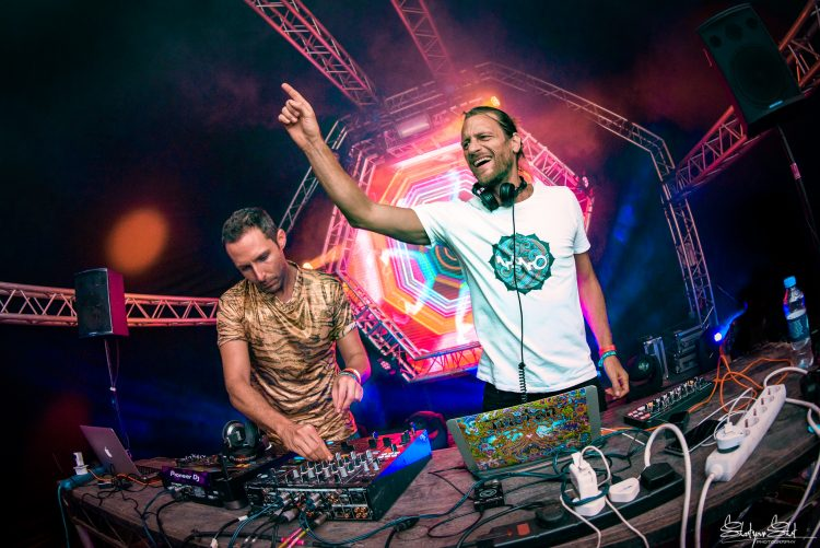 two male DJ's dancing whilst playing psytrance on the Liquid Stage during Noisily Festival 2018