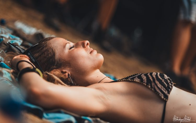 woman in a bikini sleeping on the ground during Noisily Festival 2018