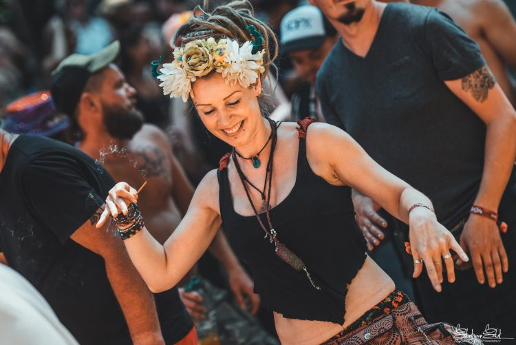 woman in flower headband dancing within Noisily Festival 2018 crowd