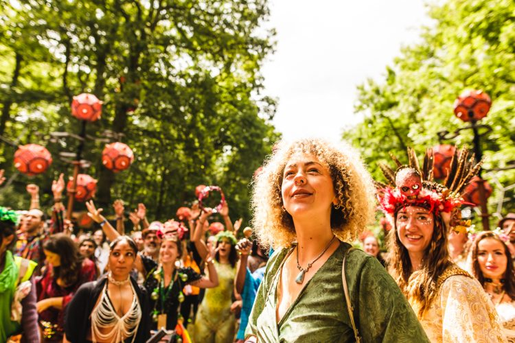 woman smiling and looking into the sky at Noisily Festival 2019