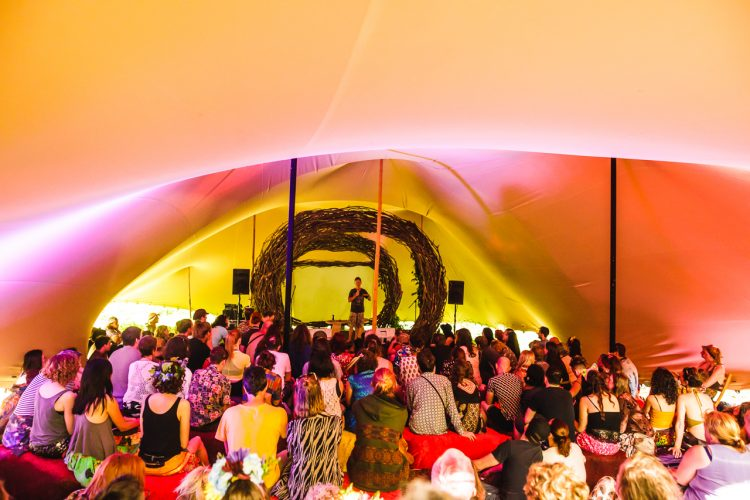 man speaking to audience inside a Mind Body Soul tent