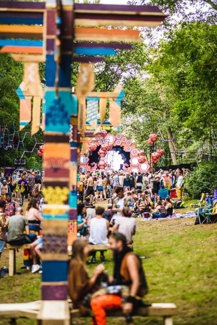 man and woman sitting underneath totem pole decoration at Noisily Festival 2019