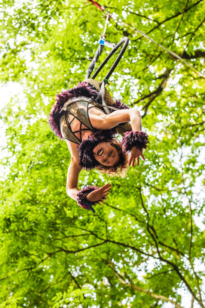 female performer hanging upside from tree during Noisily Festival 2019