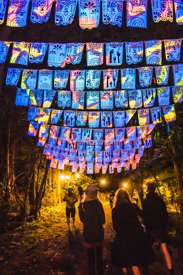 Noisily Festival 2019 attendees walking underneath glowing decorations