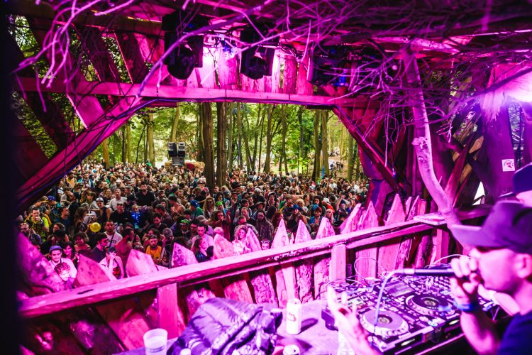 MC rapping into microphone over drum and bass in front of a Noisily Festival 2019 crowd