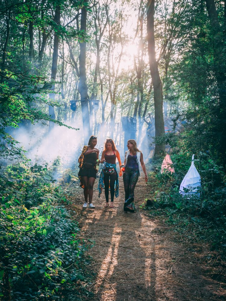 three female friends walking through the woods at Noisily Festival 2019