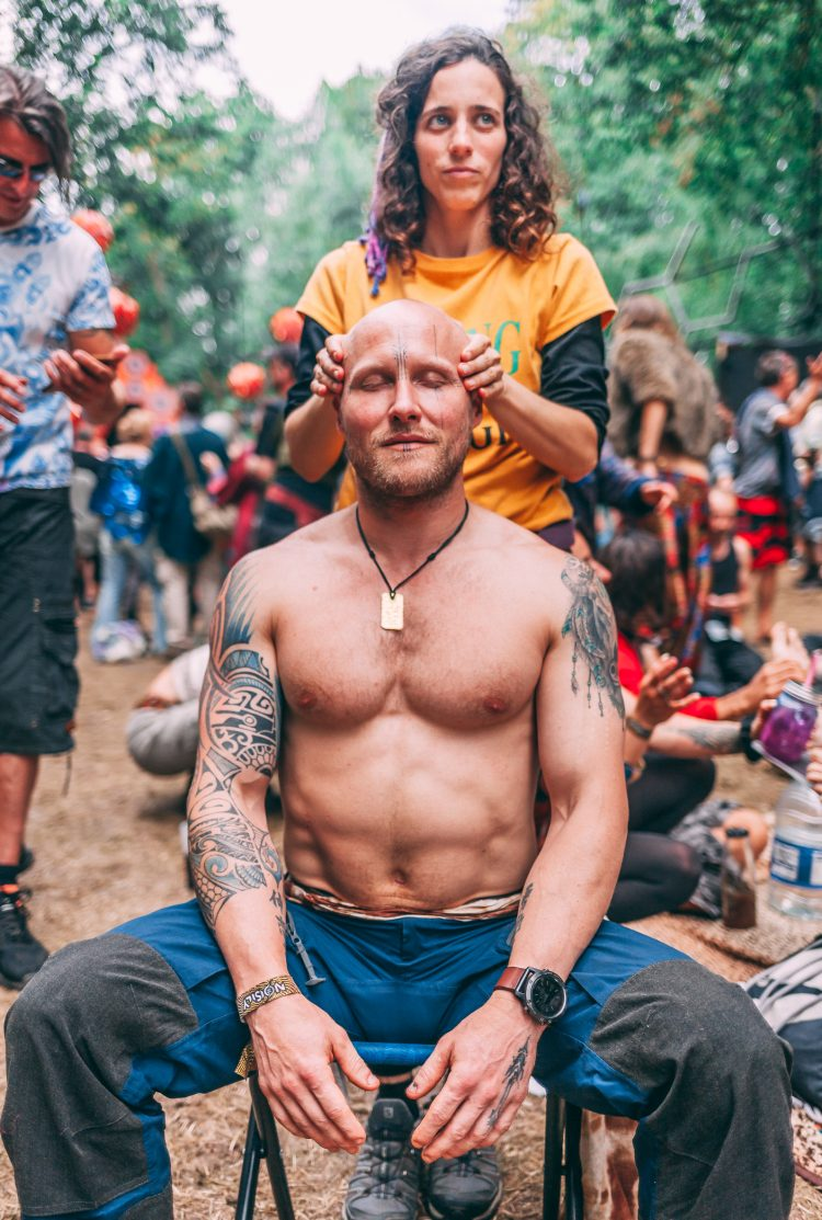 woman massaging topless man's head during Noisily Festival 2019