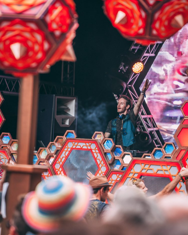 Male DJ with hand in the air playing psytrance on the Noisily Festival 2019 Liquid stage