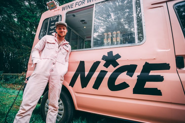Man in pink uniform standing in front of his pink ice-cream van at Noisily Festival 2019