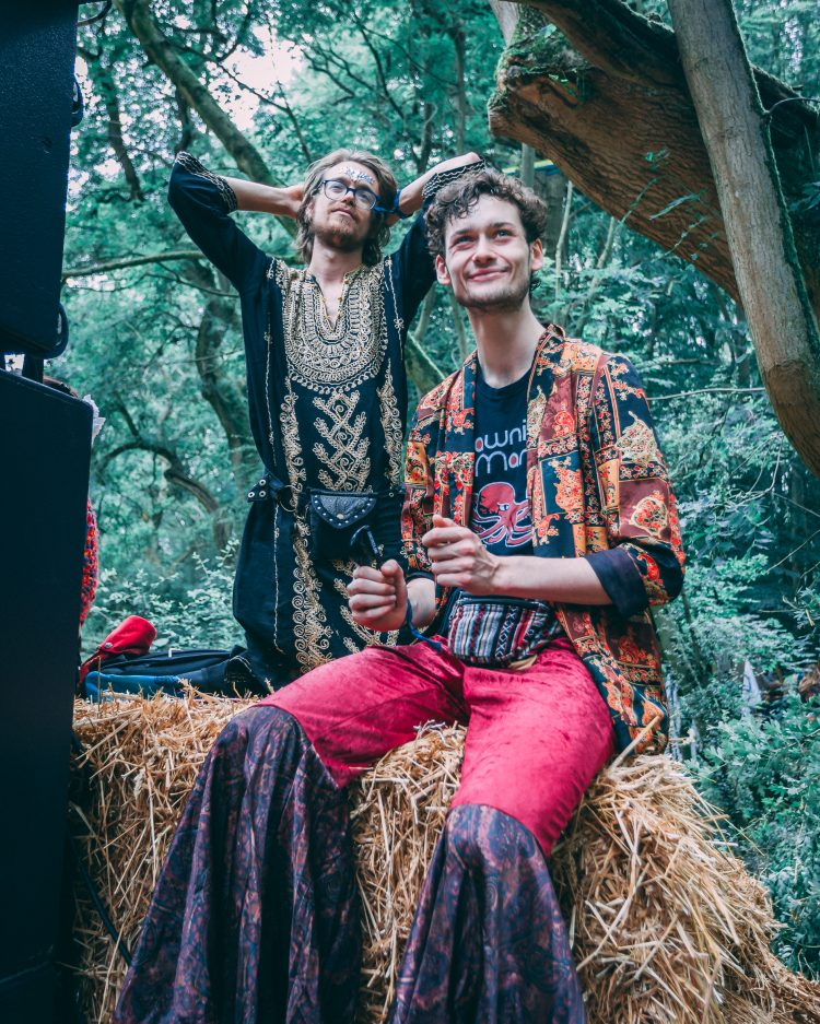 man in fancy dress sitting on a hay bale during Noisily Festival 2019