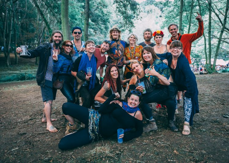 Large group of friends posing in the woods at Noisily Festival 2019