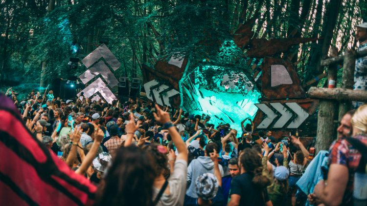 Noisily Festival 2019 crowd listening to drum and bass at the Treehouse Stage in the forest