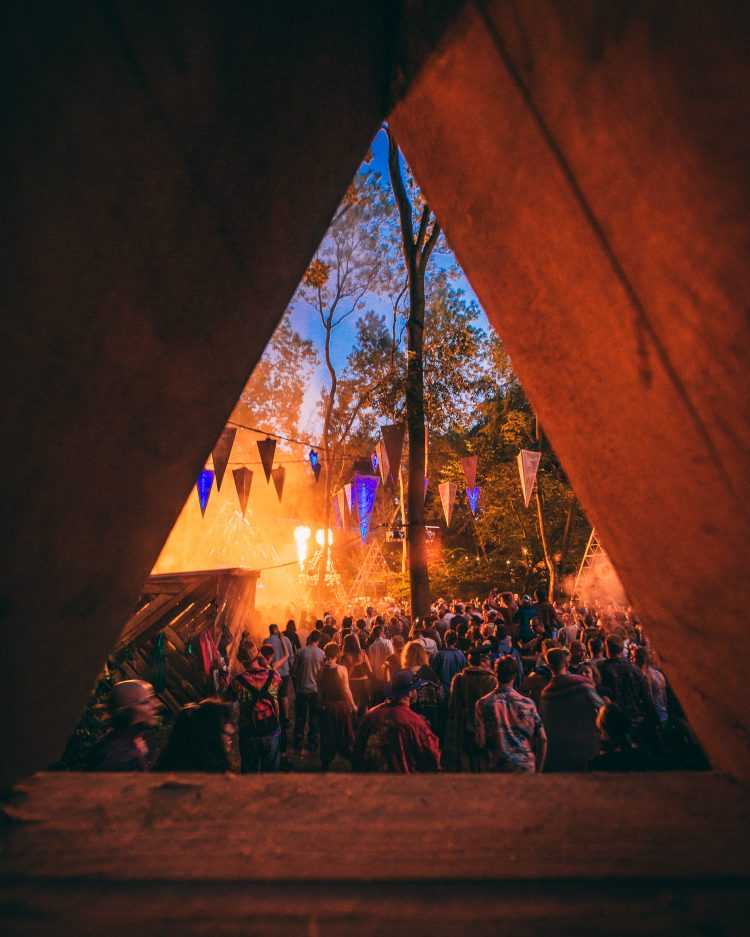Noisily Festival 2019 crowd viewed through a wooden art installation