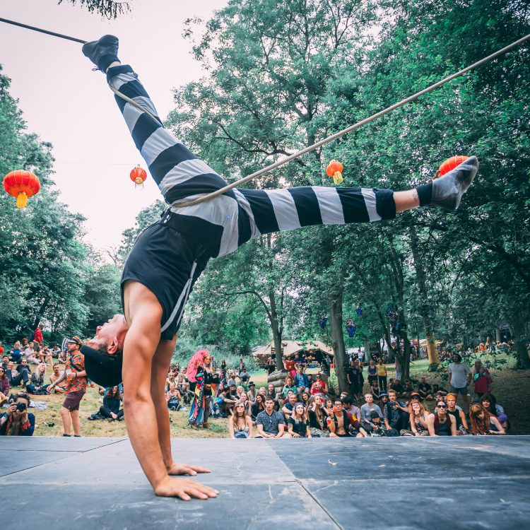 Male performer performing acrobatics on a stage at Noisily Festival 2019