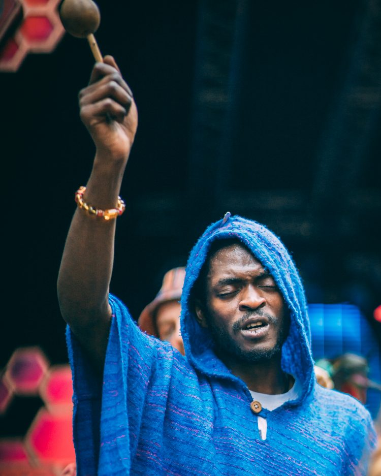 man with blue hood holding drumstick in the air at Noisily Festival 2019
