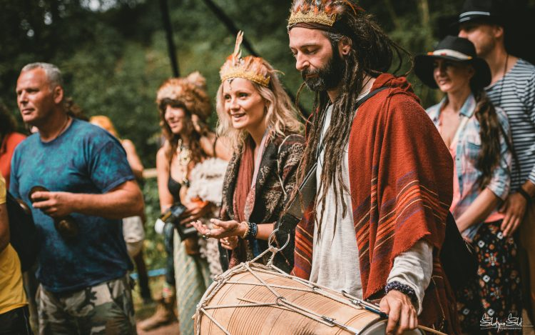 man with dreadlocks banging on drum at Noisily Festival 2019