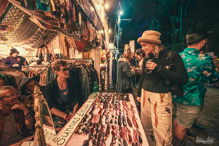Woman in hat looking at sunglasses in a clothing store at Noisily Festival 2019