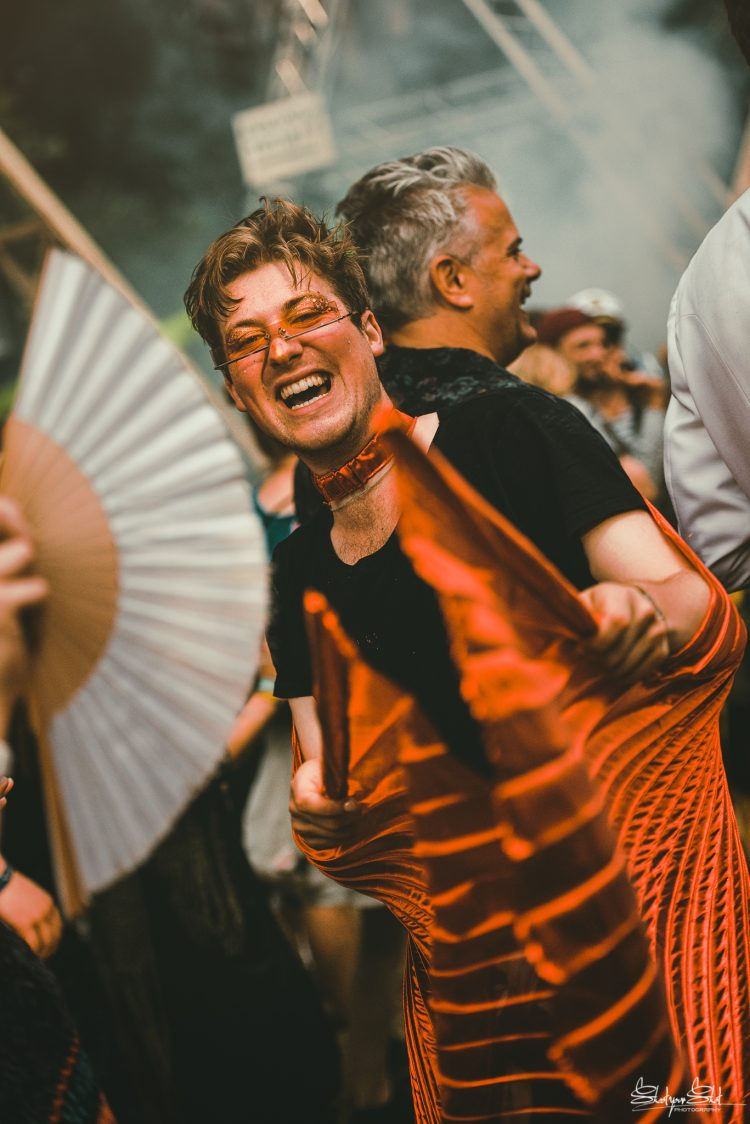 man with sunglasses dancing with giant fan at Noisily Festival 2019