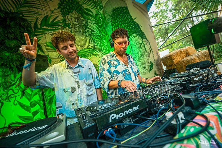 two male DJ's doing peace sign fingers on a Noisily Festival 2019 music stage