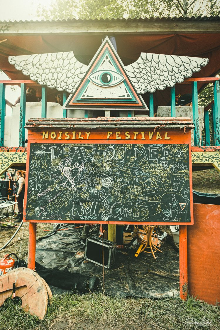 blackboard that is covered in writing at Noisily Festival 2019