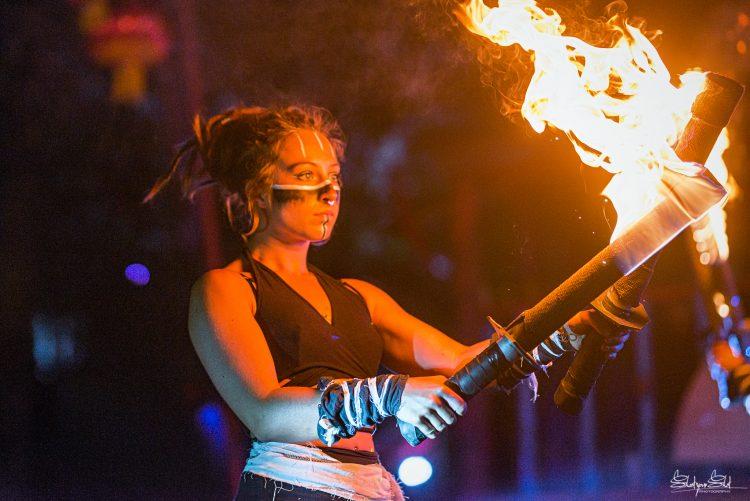 female performer holding flaming sticks at Noisily Festival 2019