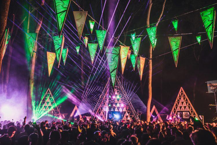 green decorations hanging above Noisily Festival 2018 music stage at night