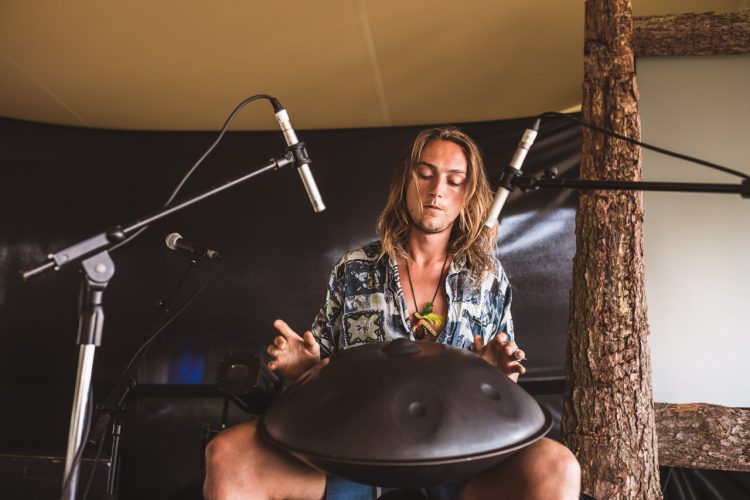 male performer bangs steel drum at a small Noisily Festival 2018 stage