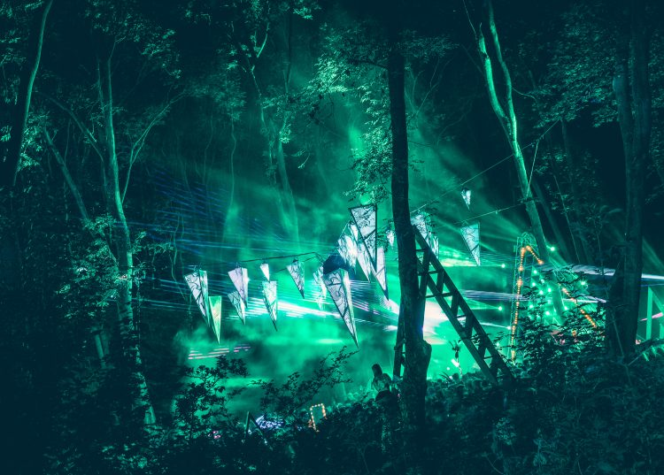 Noisily 2018 music stage viewed from coney woods at night