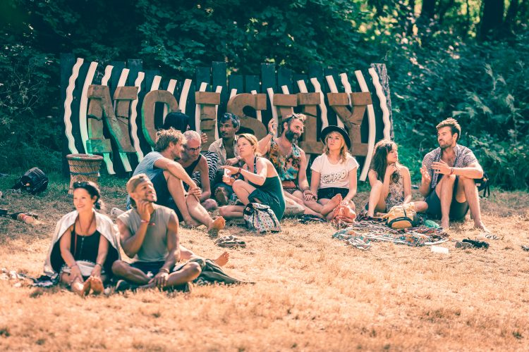 group of Noisily Festival 2018 attendees sitting on the grass