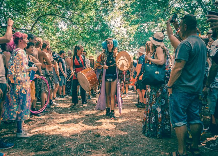 group of performers marching through coney woods at Noisily Festival 2018