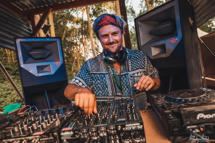 Male DJ turning knobs and smiling on a Noisily Festival 2018 stage