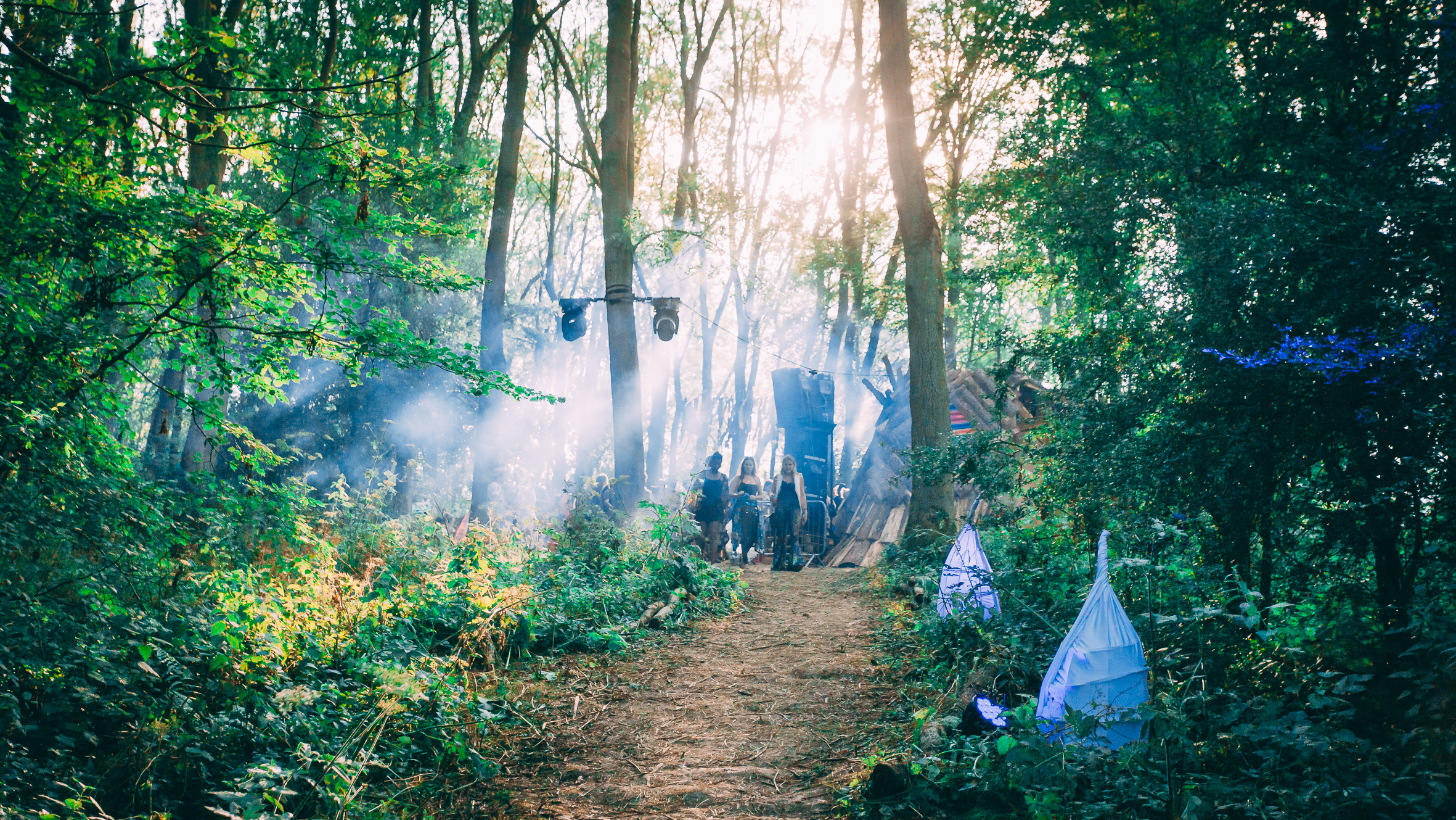 Walking in the woods on the way into a festival.